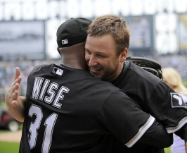 CHICAGO - JULY 23: Mark Buehrle #56 of the Chicago White Sox hugs outfielder DeWayne Wise #31 who made a great catch in the ninth inning enabling Buehrle to record the 18th perfect game in major league history against the Tampa Bay Rays on June 23, 2009 at U.S. Cellular Field in Chicago, Illinois. The White Sox defeated the Rays 5-0. (Photo by Ron Vesely)